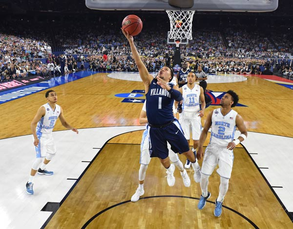 <div class='meta'><div class='origin-logo' data-origin='AP'></div><span class='caption-text' data-credit='Robert Deutsch via AP, Pool'>Villanova's Jalen Brunson (1) goes to the basket during the first half of the NCAA Final Four tournament college basketball championship game against North Carolina.</span></div>