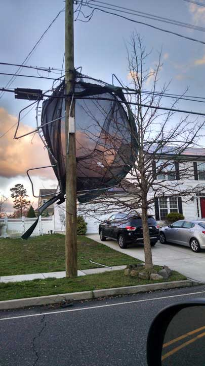 <div class='meta'><div class='origin-logo' data-origin='WPVI'></div><span class='caption-text' data-credit='Gary'>High winds toss a trampoline into power lines in Egg Harbor Twp., N.J.</span></div>