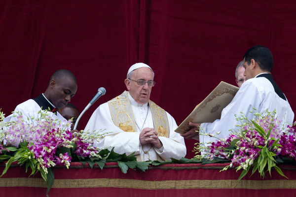 "<div class=""meta image-caption""><div class=""origin-logo origin-image none""><span>none</span></div><span class=""caption-text"">Pope Francis speaks before delivering the Urbi et Orbi (to the city and to the world) blessing at the end of the Easter Sunday Mass.  (AP Photo/ Andrew Medichini)</span></div>"