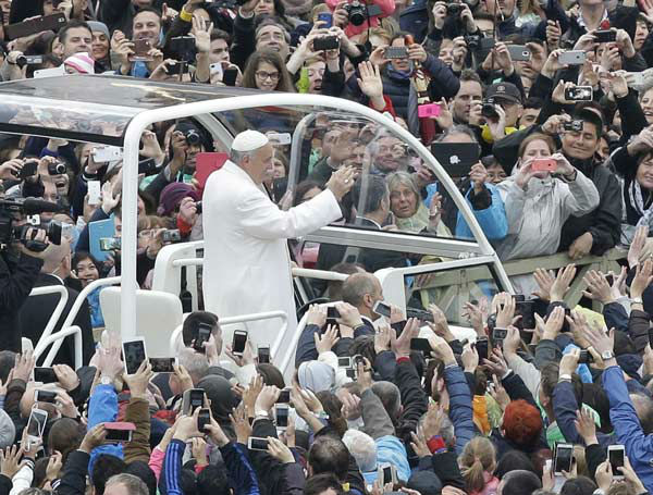 "<div class=""meta image-caption""><div class=""origin-logo origin-image none""><span>none</span></div><span class=""caption-text"">Pope Francis salutes as he arrives for an Easter mass, in St. Peter's square at the Vatican, Sunday, April 5, 2015.  (AP Photo/ Alessandra Tarantino)</span></div>"