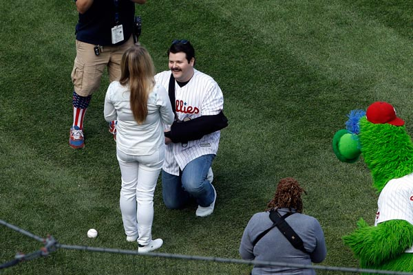 <div class='meta'><div class='origin-logo' data-origin='AP'></div><span class='caption-text' data-credit='AP Photo/Matt Rourke'>Philadelphia Police Officer Jesse Hartnett proposes to Lily Abdullina ahead of the Philadelphia Phillies home opening day baseball game against the San Diego Padres.</span></div>