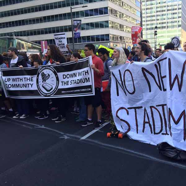 <div class='meta'><div class='origin-logo' data-origin='none'></div><span class='caption-text' data-credit=''>Protestors blasting Temple University for claiming it can't pay workers $15 then spending millions on new stadium.</span></div>