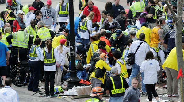 <div class='meta'><div class='origin-logo' data-origin='none'></div><span class='caption-text' data-credit=''>Pictured: The bombing of the Boston Marathon on April 15, 2013.</span></div>