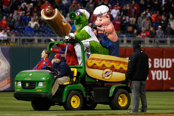 <div class='meta'><div class='origin-logo' data-origin='none'></div><span class='caption-text' data-credit='AP Photo/ Chris Szagola'>The Phillie Phanatic shoots hot dogs into the stands during the fifth inning of a baseball game against the Boston Red Sox, Thursday, April 9, 2015, in Philadelphia.</span></div>