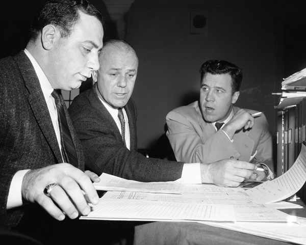 <div class='meta'><div class='origin-logo' data-origin='AP'></div><span class='caption-text' data-credit='AP Photo/Bill Ingraham'>Draft choice list is checked closely by Green Bay Packers scout Jack Vainisi, left, Packers new head coach Ray McLean, center, assistant coach Jack Morton, Jan. 28, 1958 in Phila.</span></div>