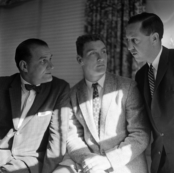 <div class='meta'><div class='origin-logo' data-origin='AP'></div><span class='caption-text' data-credit='AP Photo'>Billy Cannon, center, listens during conversation between Los Angeles Rams' coach Sid Gillman, left, and Ram's general manager Pete Rozrelle in Philadelphia, Pa., Nov. 30, 1959.</span></div>