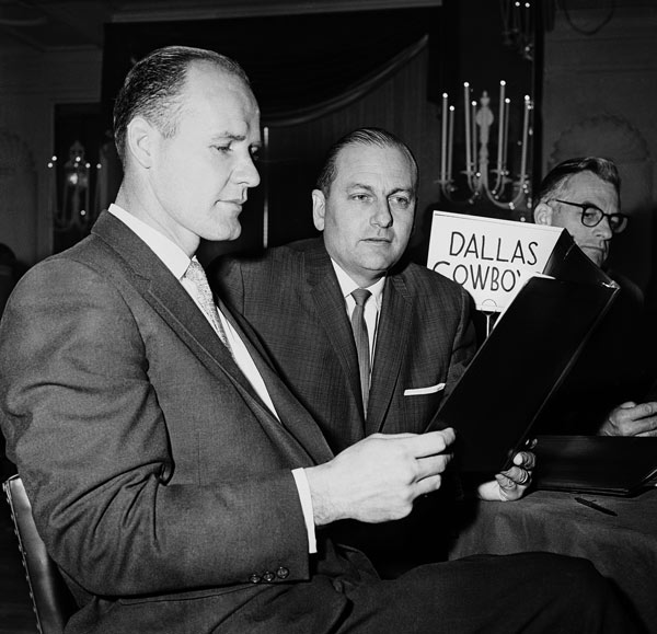 <div class='meta'><div class='origin-logo' data-origin='AP'></div><span class='caption-text' data-credit='AP Photo'>Tom Landry, left, coach of the Dallas Cowboys in the NFL, goes over draft eligibles roster at the NFL draft meeting in Philadelphia on Dec. 27, 1960 GM Tex Schramm.</span></div>