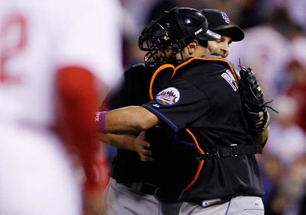 <div class='meta'><div class='origin-logo' data-origin='AP'></div><span class='caption-text' data-credit='AP Photo/Matt Slocum'>New York Mets relief pitcher Taylor Buchholz, rear, and catcher Ronny Paulino hug after winning a baseball game against the New York Mets, early Monday morning, May 2, 2011.</span></div>
