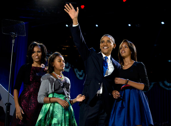 "<div class=""meta image-caption""><div class=""origin-logo origin-image ap""><span>AP</span></div><span class=""caption-text"">President Barack Obama waves as he walks on stage with first lady Michelle Obama and daughters Malia and Sasha at his election night party Wednesday, Nov. 7, 2012, in Chicago. (AP Photo/Carolyn Kaster)</span></div>"
