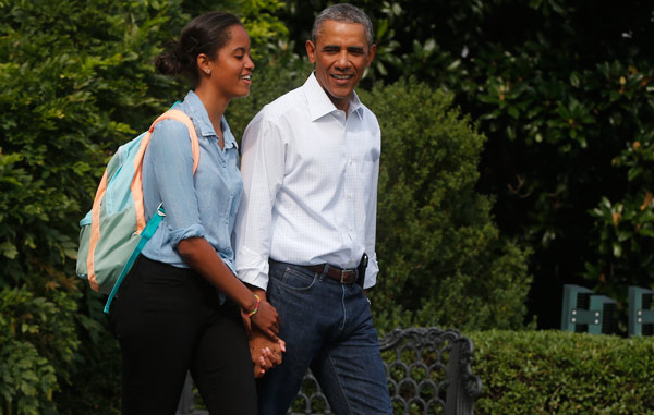 "<div class=""meta image-caption""><div class=""origin-logo origin-image ap""><span>AP</span></div><span class=""caption-text"">President Barack Obama walks with his daughter Malia on the South Lawn of the White House in Washington, Tuesday, Aug. 19, 2014, as he returns to Martha's Vineyard. (AP Photo/Charles Dharapak)</span></div>"