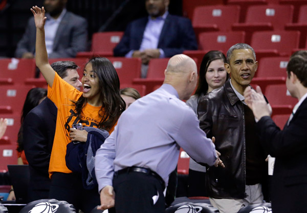 "<div class=""meta image-caption""><div class=""origin-logo origin-image ap""><span>AP</span></div><span class=""caption-text"">Malia Obama waves to her cousin as she walks to her seats behind President Barack Obama before an NCAA college basketball game between Princeton and Wisconsin-Green Bay in 2015. (AP Photo/Patrick Semansky)</span></div>"