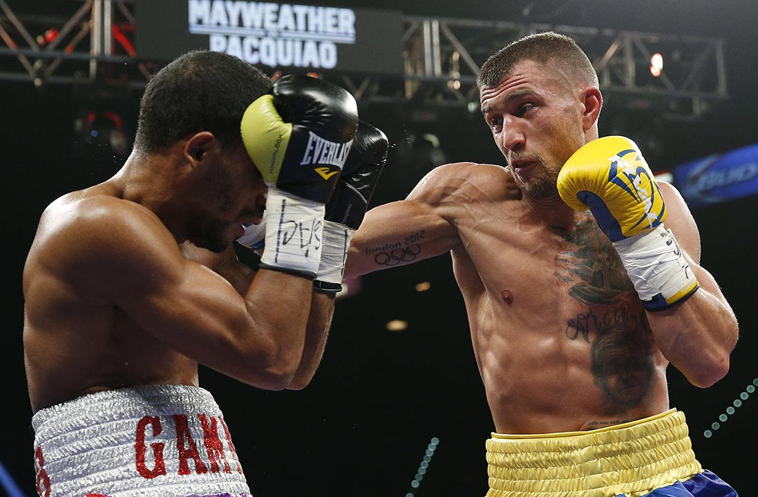 <div class='meta'><div class='origin-logo' data-origin='none'></div><span class='caption-text' data-credit='AP Photo/John Locher'>Vasyl Lomachenko, right, of the Ukraine lands a right against Gamalier Rodriguez, of Puerto Rico, during their featherweight title fight on Saturday, May 2, 2015 in Las Vegas.</span></div>