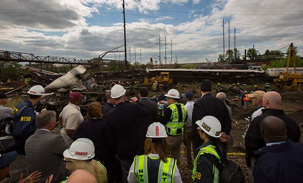 <div class='meta'><div class='origin-logo' data-origin='none'></div><span class='caption-text' data-credit='National Transportation Safety Board'>The NTSB Go Team arrives on the scene of the Amtrak Train #188 Derailment in Philadelphia, PA</span></div>