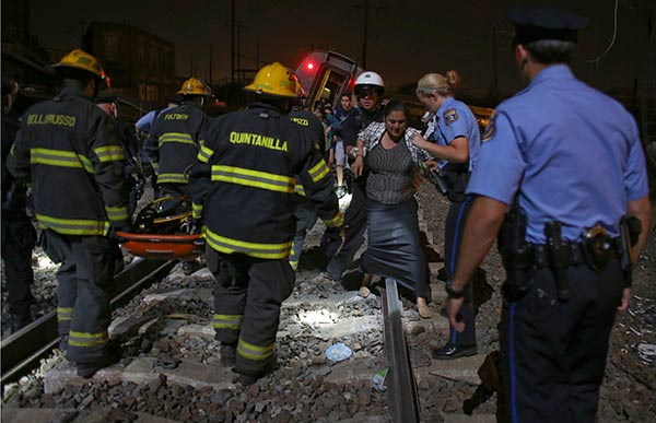 <div class='meta'><div class='origin-logo' data-origin='AP'></div><span class='caption-text' data-credit='AP Photo/Joseph Kaczmarek'>Emergency personnel help a passenger at the scene of a train wreck, Tuesday, May 12, 2015, in Philadelphia.</span></div>