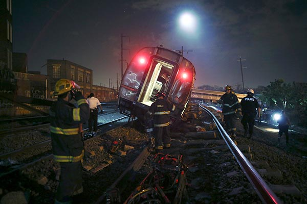<div class='meta'><div class='origin-logo' data-origin='AP'></div><span class='caption-text' data-credit='AP Photo/ Joseph Kaczmarek'>Emergency personnel work the scene of a deadly train wreck, Tuesday, May 12, 2015, in Philadelphia.</span></div>