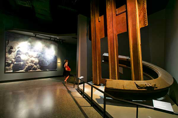 A two-inch thick World Trade Center steel column, that was bent into a horseshoe shape, and facade segment, are displayed at the National Sept. 11 Memorial Museum. (AP Photo) <span class=meta>Photo/Uncredited</span>