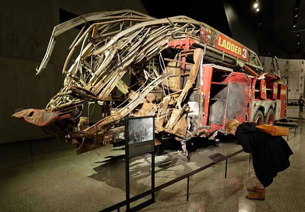 "<div class=""meta image-caption""><div class=""origin-logo origin-image ""><span></span></div><span class=""caption-text"">A firetruck, damaged in the attacks of September 11, 2001, is on display at the Sept. 11 museum. New York museum. (AP Photo) (Photo/Uncredited)</span></div>"
