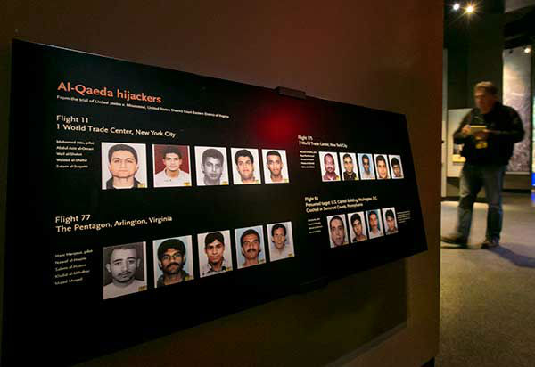 <div class='meta'><div class='origin-logo' data-origin='none'></div><span class='caption-text' data-credit='Photo/Uncredited'>Portraits of the Al-Qaeda hijackers are displayed at the National Sept. 11 Memorial Museum(AP Photo)</span></div>