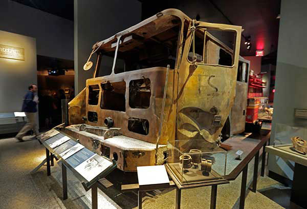 <div class='meta'><div class='origin-logo' data-origin='none'></div><span class='caption-text' data-credit='Photo/Uncredited'>The remains of New York City Fire Dept. truck from Engine Company 21 are displayed at the National Sept. 11 Memorial Museum,(AP Photo)</span></div>