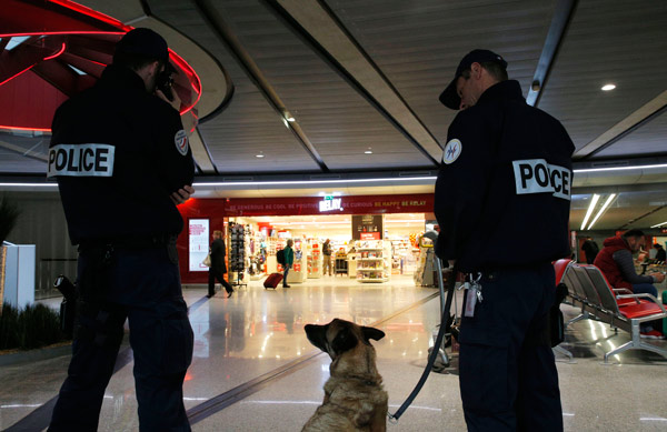 <div class='meta'><div class='origin-logo' data-origin='AP'></div><span class='caption-text' data-credit='AP Photo/Christophe Ena'>Police officers patrol at Charles de Gaulle airport, outside of Paris, Thursday, May 19, 2016.</span></div>