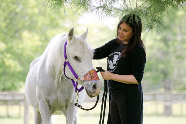 <div class='meta'><div class='origin-logo' data-origin='AP'></div><span class='caption-text' data-credit='AP Photo/Matt Rourke'>Tracey Stewart stands besides Lily the horse she is adopting during a news conference Wednesday, May 25, 2016, in Kennett Square, Pa.</span></div>