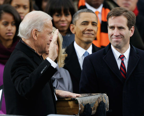 "<div class=""meta image-caption""><div class=""origin-logo origin-image none""><span>none</span></div><span class=""caption-text"">President Barack Obama, center and Beau Biden, Attorney of Deleware, right, watch as his father Joe Biden is sworn in at the ceremonial swearing-in. (AP Photo/ Pablo Martinez Monsivais)</span></div>"