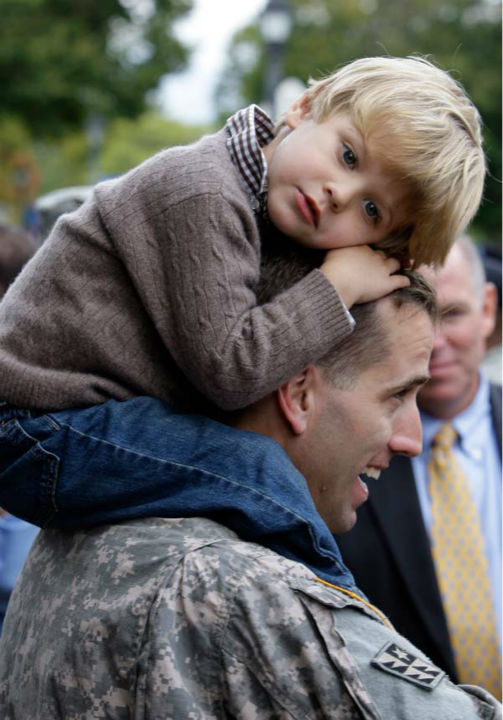 "<div class=""meta image-caption""><div class=""origin-logo origin-image none""><span>none</span></div><span class=""caption-text"">Capt. Beau Biden carries his son Hunter, 3, on his shoulders after an official welcome home ceremony for members of the Delaware Army National Guard 261st Signal Brigade. (AP Photo/ Rob Carr)</span></div>"