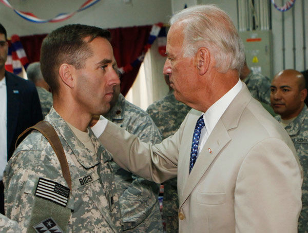 "<div class=""meta image-caption""><div class=""origin-logo origin-image none""><span>none</span></div><span class=""caption-text"">U.S. Vice President Joe Biden, right, talks with his son, U.S. Army Capt. Beau Biden, at Camp Victory on the outskirts of Baghdad, Iraq, Saturday, July 4, 2009.  (AP Photo/ Khalid Mohammed)</span></div>"
