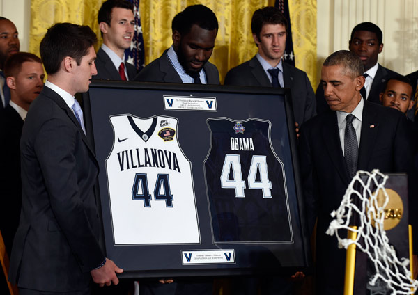 <div class='meta'><div class='origin-logo' data-origin='AP'></div><span class='caption-text' data-credit='AP Photo/Pablo Martinez Monsivais'>President Barack Obama, right, receives a gift from NCAA Champion Villanova men's basketball team members Ryan Arcidiacono, left, and Daniel Ochefu, center.</span></div>