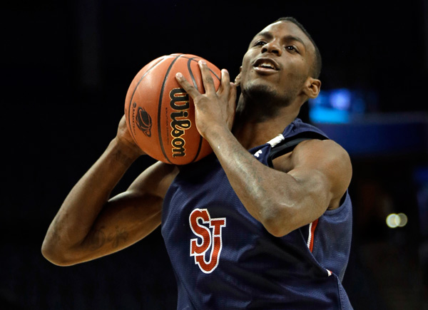 <div class='meta'><div class='origin-logo' data-origin='AP'></div><span class='caption-text' data-credit='AP Photo/Gerald Herbert'>St. John's Rysheed Jordan grabs a rebound during practice at the NCAA college basketball tournament in Charlotte, N.C., Thursday, March 19, 2015.</span></div>