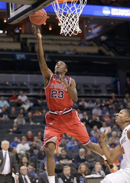 <div class='meta'><div class='origin-logo' data-origin='AP'></div><span class='caption-text' data-credit='AP Photo/Nell Redmond'>St. John's Rysheed Jordan (23) drives to the basket against San Diego State during the second half of an NCAA tournament college basketball game in the Round of 64 in Charlotte.</span></div>
