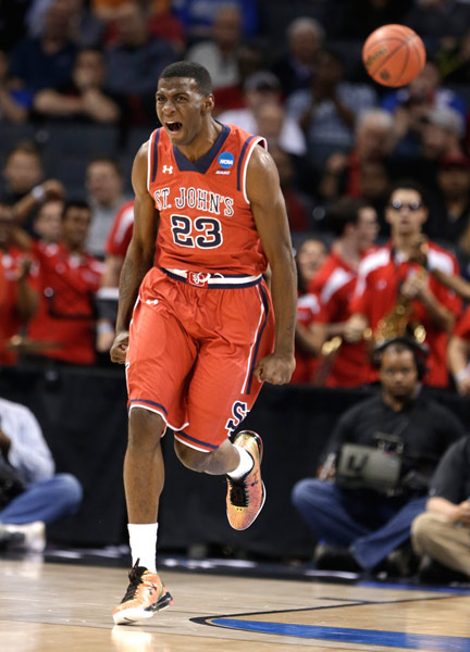 <div class='meta'><div class='origin-logo' data-origin='AP'></div><span class='caption-text' data-credit='AP Photo/Gerald Herbert'>St. John's Rysheed Jordan (23) celebrates after a dunk against San Diego State during the second half of an NCAA tournament college basketball game in the Round of 64 in Charlotte,</span></div>
