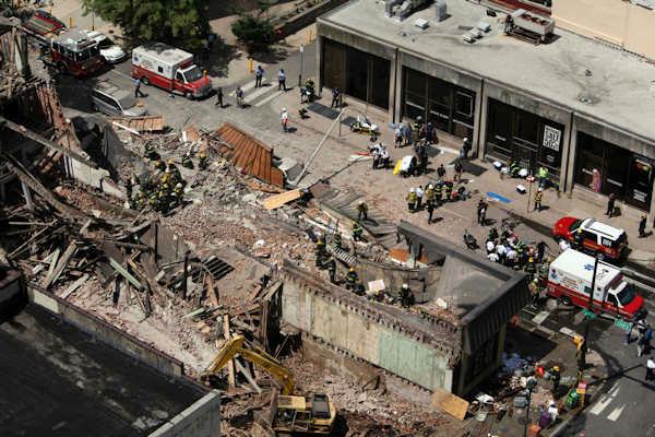<div class='meta'><div class='origin-logo' data-origin='none'></div><span class='caption-text' data-credit=''>Rescue personnel work the scene of a building collapse in Center City Philadelphia on June 5, 2013.</span></div>