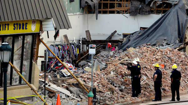 <div class='meta'><div class='origin-logo' data-origin='none'></div><span class='caption-text' data-credit=''>Firefighters view the aftermath of a building collapse on Thursday, June 6, 2013 in Philadelphia.</span></div>