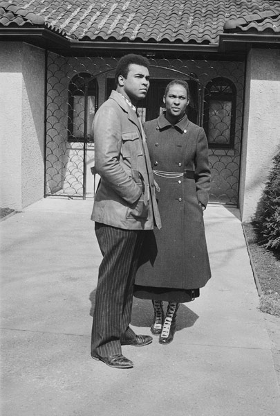 "<div class=""meta image-caption""><div class=""origin-logo origin-image ap""><span>AP</span></div><span class=""caption-text"">Muhammad Ali and his wife Belinda are seen standing in front of their new home in Cherry Hill, N.J., in this March 22, 1971 photo. (AP Photo)</span></div>"