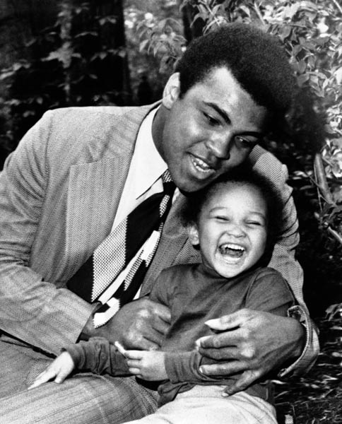 <div class='meta'><div class='origin-logo' data-origin='AP'></div><span class='caption-text' data-credit='AP Photo/WMW'>Muhammad Ali plays with his three-year-old daughter Marryum, at his home at Cherry Hill, New Jersey on Monday, June 14, 1971.</span></div>