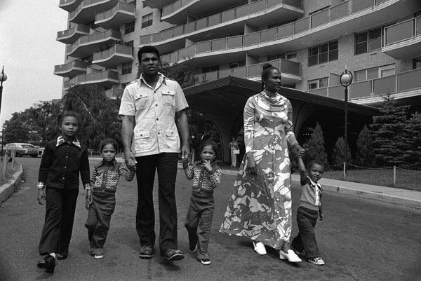 "<div class=""meta image-caption""><div class=""origin-logo origin-image ap""><span>AP</span></div><span class=""caption-text"">Former heavyweight boxing champion Muhammad Ali and his family walk in front of their apartment building in Cherry Hill, N.J., Aug. 24, 1974.</span></div>"