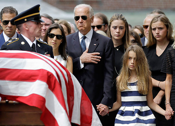 """<div class=""""meta image-caption""""><div class=""""origin-logo origin-image none""""><span>none</span></div><span class=""""caption-text"""">VP Joe Biden, with his family, holds his hand over his heart as he watches an honor guard carry a casket containing the remains of his son, Beau. (AP Photo/Patrick Semansky)</span></div>"""