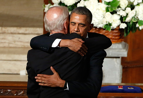 "<div class=""meta image-caption""><div class=""origin-logo origin-image none""><span>none</span></div><span class=""caption-text"">President Barack Obama hugs Vice President Joe Biden during funeral services for Biden's son, Beau Biden, Saturday, June 6, 2015  (Yuri Gripas/Pool Photo via AP)</span></div>"