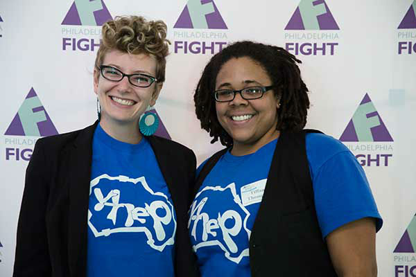 "<div class=""meta image-caption""><div class=""origin-logo origin-image ""><span></span></div><span class=""caption-text"">Pictured: Institute of Community Justice Hannah Zellman and Director of Y-HEP Tiffany Thompson at Step Up Against AIDS. 20th Anniversary of AIDS Education Month. (Photo/Holly E Clark)</span></div>"