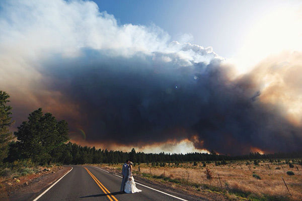 "<div class=""meta image-caption""><div class=""origin-logo origin-image ""><span></span></div><span class=""caption-text"">Michael Wolber and April Hartley had to evacuate from their own wedding as a wildfire burned in Bend, Oregon on Saturday - but not before getting a few pictures! (Josh Newton)</span></div>"