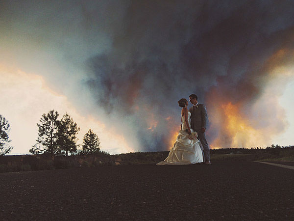 Michael Wolber and April Hartley had to evacuate from their own wedding as a wildfire burned in Bend, Oregon on Saturday - but not before getting a few pictures! <span class=meta>(Josh Newton)</span>