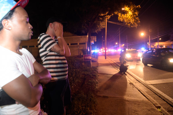 <div class='meta'><div class='origin-logo' data-origin='AP'></div><span class='caption-text' data-credit='AP Photo/Phelan M. Ebenhack'>Jermaine Towns, left, and Brandon Shuford wait down the street from a multiple shooting at a nightclub in Orlando, Fla., Sunday, June 12, 2016.</span></div>