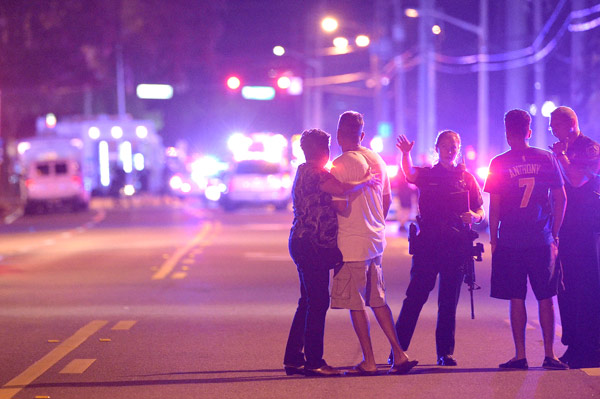 <div class='meta'><div class='origin-logo' data-origin='AP'></div><span class='caption-text' data-credit='AP Photo/Phelan M. Ebenhack'>Orlando Police officers direct family members away from a multiple shooting at a nightclub in Orlando, Fla., Sunday, June 12, 2016.</span></div>