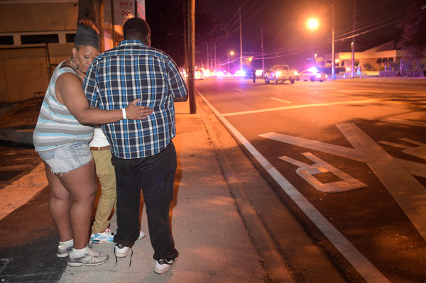 <div class='meta'><div class='origin-logo' data-origin='AP'></div><span class='caption-text' data-credit='AP Photo/Phelan M. Ebenhack'>Bystanders wait down the street from a multiple shooting at the Pulse nightclub in Orlando, Fla., Sunday, June 12, 2016.</span></div>