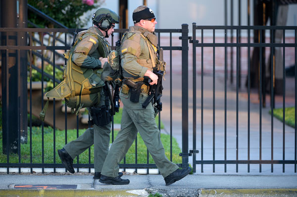 <div class='meta'><div class='origin-logo' data-origin='AP'></div><span class='caption-text' data-credit='AP Photo/Phelan M. Ebenhack'>Orange County Sheriff's Department SWAT members arrive to a fatal shooting at Pulse Orlando nightclub in Orlando, Fla., Sunday, June 12, 2016.</span></div>