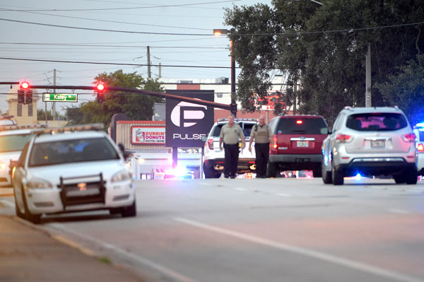 <div class='meta'><div class='origin-logo' data-origin='AP'></div><span class='caption-text' data-credit='AP Photo/Phelan M. Ebenhack'>Police cars surround the Pulse Orlando nightclub, the scene of a fatal shooting, in Orlando, Fla., Sunday, June 12, 2016.</span></div>