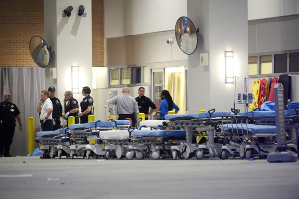 <div class='meta'><div class='origin-logo' data-origin='AP'></div><span class='caption-text' data-credit='AP Photo/Phelan M. Ebenhack'>Emergency personnel wait with stretchers at the emergency entrance to Orlando Regional Medical Center.</span></div>