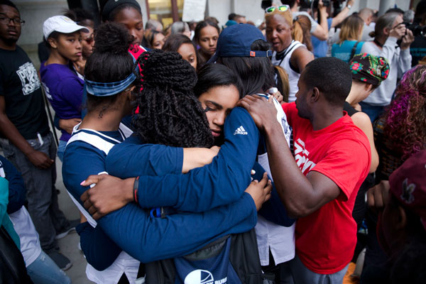 <div class='meta'><div class='origin-logo' data-origin='AP'></div><span class='caption-text' data-credit='AP Photo/Matt Rourke'>Mourners from West Catholic Preparatory High School embrace during a vigil in memory of the victims of the Orlando, Fla., mass shooting.</span></div>