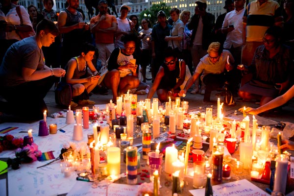 <div class='meta'><div class='origin-logo' data-origin='AP'></div><span class='caption-text' data-credit='AP Photo/Matt Rourke'>People gather for a vigil in memory of the victims of the Orlando, Fla., worst mass shooting in modern U.S. history, Monday, June 13, 2016, at City Hall in Philadelphia.</span></div>